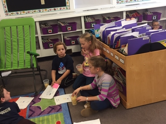 Students worked in cross grade level teams to share reading.