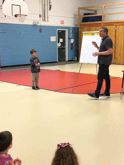 Mr. Tavares selected a first grade student as the subject for his baseball drawing.