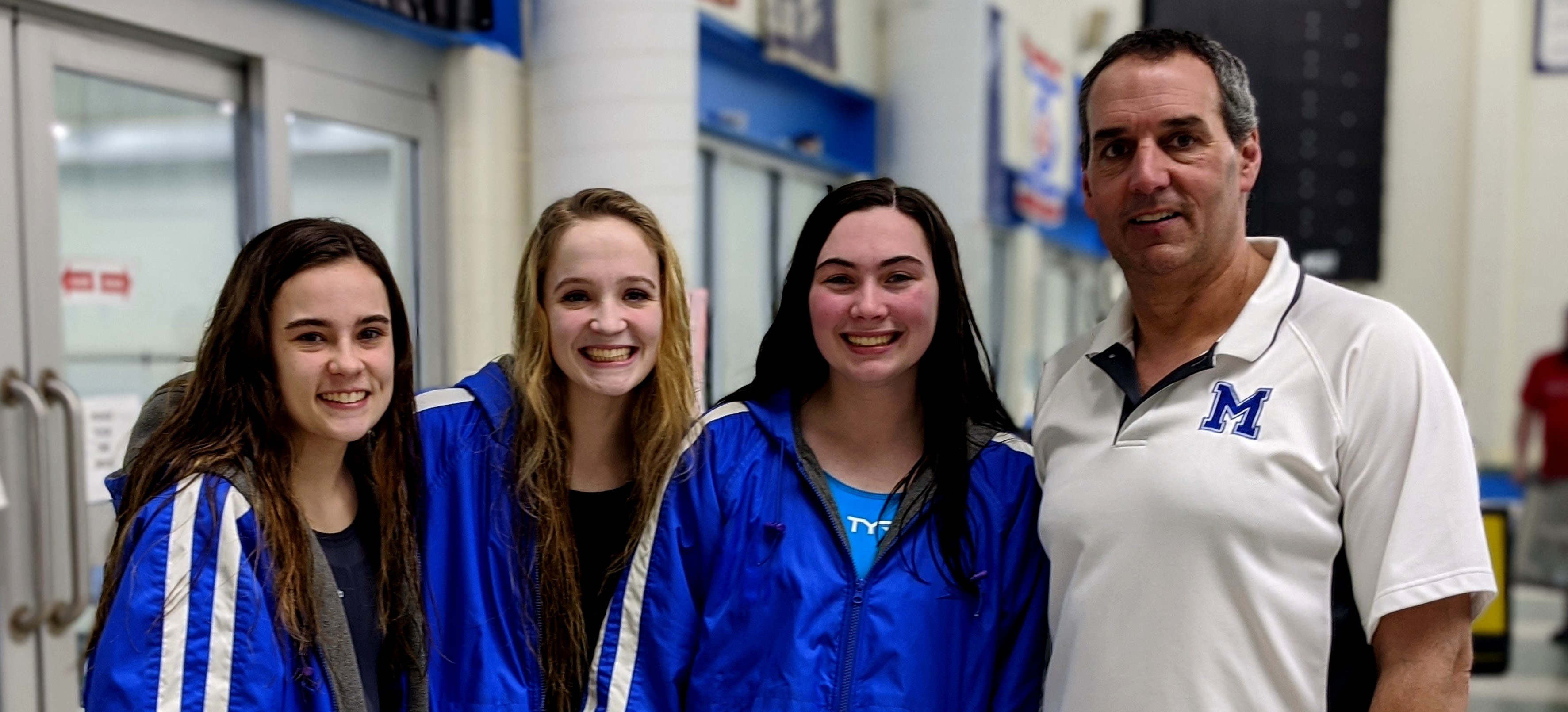 Senior swimmers with Coach Marco